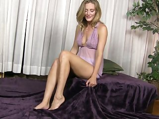 Horny mama Mona Wales is masturbating her delicious wet pussy on the top of the lie alongside