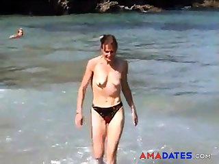 girl topless on beach with small exposed saggy tits