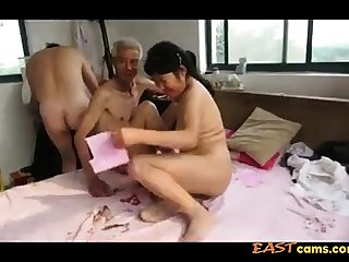 Asian Grandpa Trio with adult woman