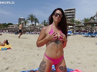 Alluring bikini girl Charlotte P takes some horny poses on the seaside