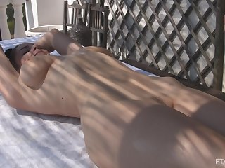 Stunning outdoor massage plus lesbian fisting broadly in the sun